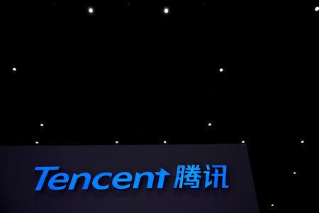 FILE PHOTO: A Tencent sign is seen during the fourth World Internet Conference in Wuzhen, Zhejiang province, China, Dec. 4, 2017. REUTERS/Aly Song