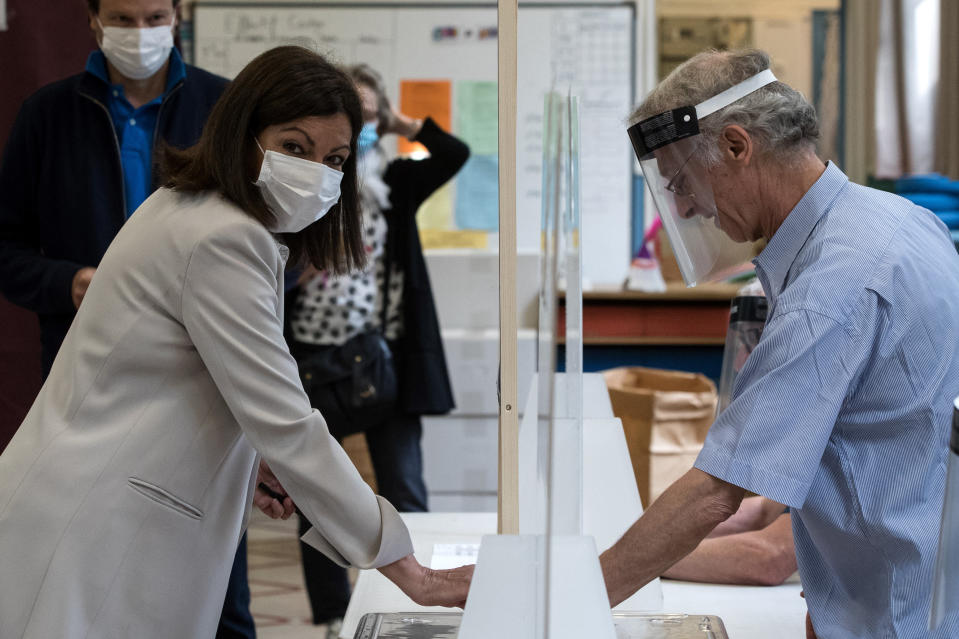 Current socialist Paris mayor and candidate in the second round of the municipal elections Anne Hidalgo casts her ballot Sunday, June 28, 2020 in Paris. France is holding the second round of municipal elections in 5,000 towns and cities Sunday that got postponed due to the country's coronavirus outbreak. (Joel Saget, Pool via AP)
