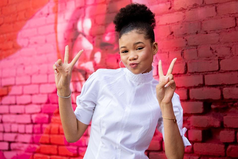 """<p>When in doubt, put your afro into a tight ponytail like actress <strong>Storm Reid</strong>. The key to keeping the front of your hair smooth (and your edges down) is to tie the front of your hair with a silk scarf as you let your <a href=""""https://www.goodhousekeeping.com/beauty/hair/a32690879/best-curly-hair-products/"""" rel=""""nofollow noopener"""" target=""""_blank"""" data-ylk=""""slk:curl control product"""" class=""""link rapid-noclick-resp"""">curl control product</a> dry and set the look. </p>"""