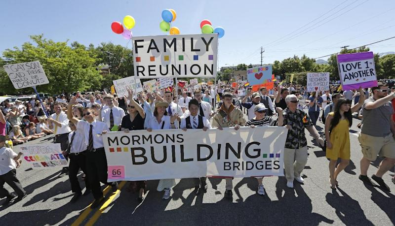 FILE - In this June 2, 2013 file photo, members of the Mormons Building Bridges march during the Utah Gay Pride Parade in Salt Lake City. A three-day conference opens Friday, Sept. 13, 2013 to explore how the Mormon faith is dealing with gays and lesbians. (AP Photo/Rick Bowmer, File)