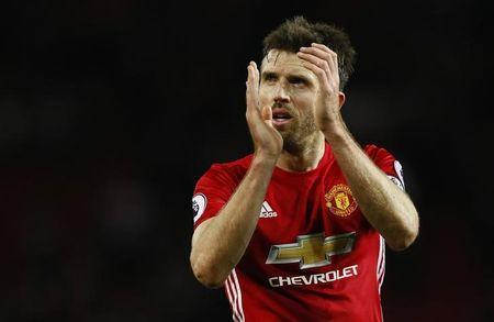 Manchester United's Michael Carrick applauds fans after the game