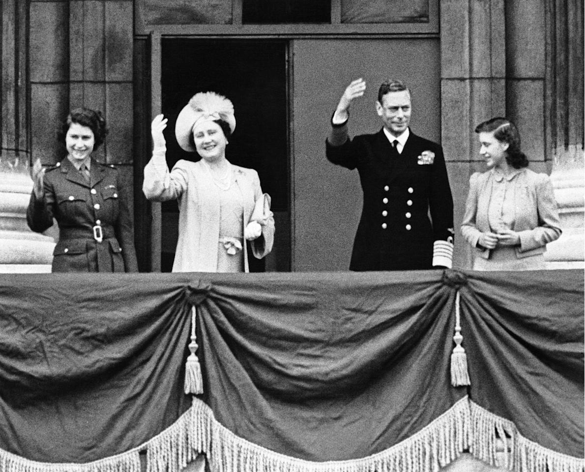 FILE - In this May 8, 1945 file photo, the British royal family, from left, Princess Elizabeth, Queen Elizabeth, King George VI and Princess Margaret, stand on a balcony in Buckingham Palace and wave to Londoners celebrating the official announcement of Germany's unconditional surrender. (AP Photo, file)