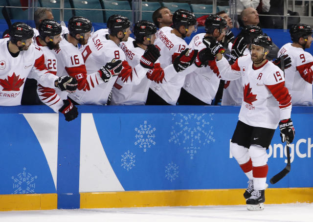 Andrew Ebbett (19), of Canada, celebrates after scoring a goal against the Czech Republic during the first period of the men's bronze medal hockey game at the 2018 Winter Olympics in Gangneung, South Korea, Saturday, Feb. 24, 2018. (AP Photo/Jae C. Hong)