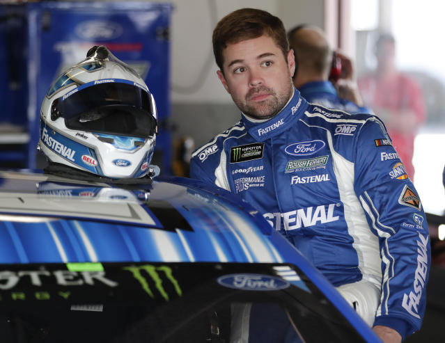 "<a class=""link rapid-noclick-resp"" href=""/nascar/sprint/drivers/1633/"" data-ylk=""slk:Ricky Stenhouse Jr"">Ricky Stenhouse Jr</a>. climbs in his car during a NASCAR auto racing practice session at Daytona International Speedway, Saturday, Feb. 10, 2018, in Daytona Beach, Fla. (AP Photo/John Raoux)"