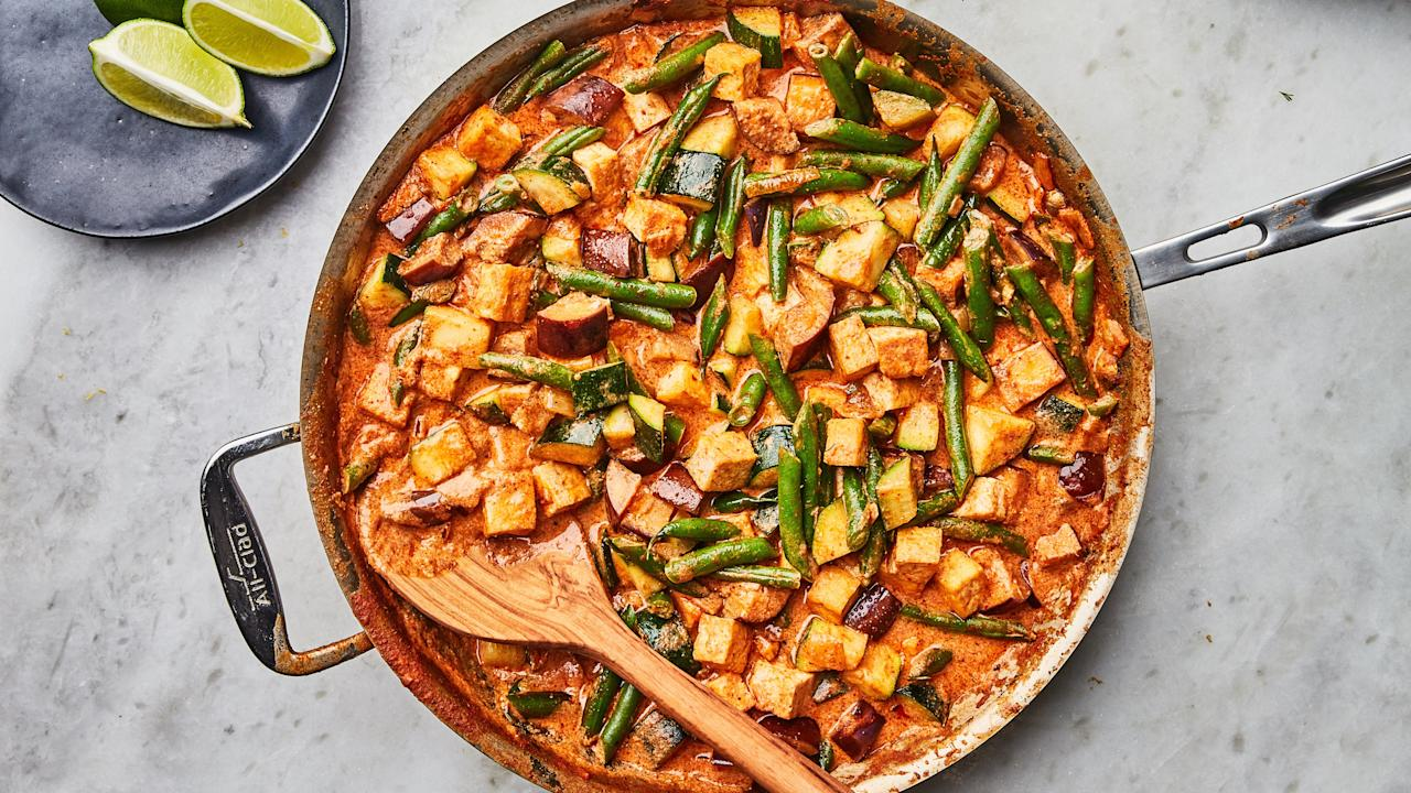 """This quick vegetarian curry is a great way to use a CSA's bounty of eggplant and summer squash. Feel free to change that lineup depending on your haul. You can eat the curry as is, or ladle it over cooked noodles or rice to add some heft. <a href=""""https://www.epicurious.com/recipes/food/views/tofu-eggplant-zucchini-curry?mbid=synd_yahoo_rss"""">See recipe.</a>"""