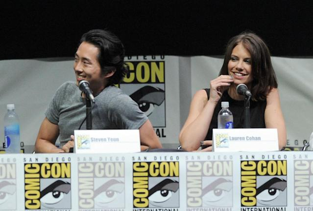"Steven Yeun and Lauren Cohan speak onstage at AMC's ""The Walking Dead"" panel during Comic-Con International 2013 at San Diego Convention Center on July 19, 2013 in San Diego, California."