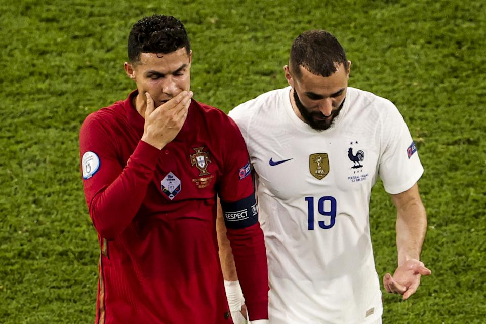 BUDAPEST, HUNGARY - JUNE 23: Cristiano Ronaldo (7) of Portugal and Karim Benzema (19) of France leave the pitch together during a break in the EURO 2020 Group F match between Portugal and France at Ferenc Puskas Stadium in Budapest, Hungary on June 23, 2021. (Photo by Dmitriy Golubovich/Anadolu Agency via Getty Images)