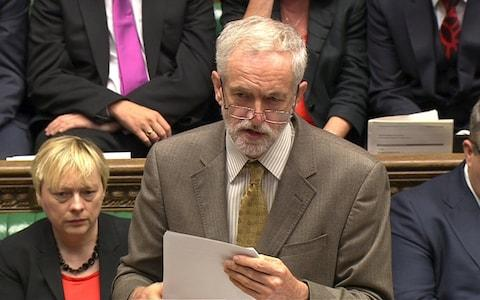 Corbyn sporting an old pair of spectacles during his first session of Prime Minister's Questions as leader in September 2015 - Credit: REUTERS
