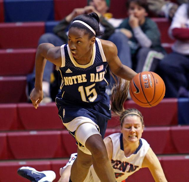 Notre Dame's Lindsay Allen (15) moves the ball up court after a rebound against Penn in the first half of an NCAA college basketball game Saturday Nov. 23, 2013, in Philadelphia. (AP Photo/H. Rumph Jr)