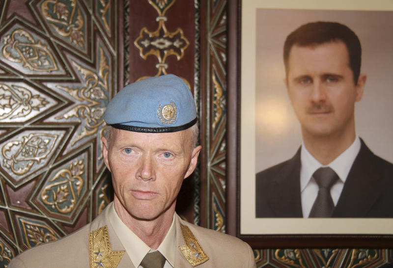 Norwegian Maj. Gen. Robert Mood, head of the U.N. observer team in Syria, is seen next to a portrait of President Bashar Assad after his arrival in Damascus, Sunday, April 29, 2012. Under the peace plan, the U.N. is to deploy as many as 300 truce monitors. One hundred should be in the country by mid-May, and the head of the observer team, Norwegian Maj. Gen. Robert Mood, arrived in Damascus on Sunday to assume command, according to the mission's spokesman, Neeraj Singh.(AP Photo/Bassem Tellawi)