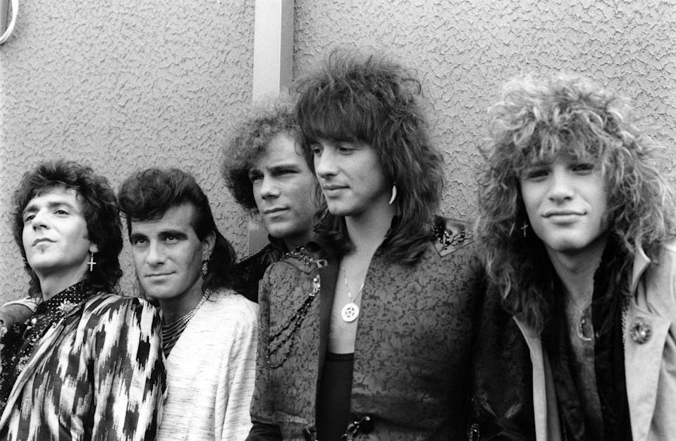 """<p>Originally consisting of Jon Bon Jovi, David Bryan, Tico Torres, Alex John Such and Richie Sambora these Jersey Boys blended rock and pop to create some very popular hits. Their debut single """"Runaway"""" was a Top 40 hit, and their third album """"Slippery When Wet"""" had a host of hits, including """"You Give Love a Bad Name"""" and Livin' on a Prayer."""" They followed that with """"New Jersey"""" which featured """"I'll Be There for You"""" and """"Bad Medicine."""" And both Sambora and Jon Bon Jovi released solo records in the early 90s. </p>"""