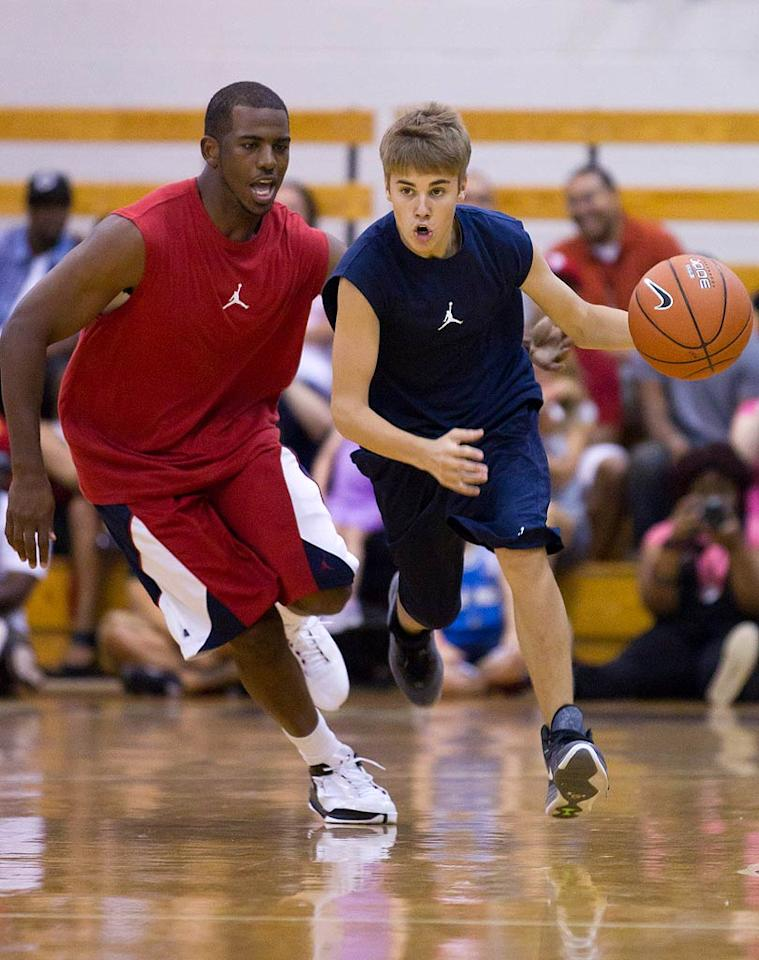 "Justin Bieber showed off his sporty side while playing in Ludacris' annual charity basketball game in Atlanta, Georgia. Interestingly enough, the teen idol's team beat Luda's squad, which included NBA stars Chris Paul and Carmelo Anthony! ""We were down and then made a crazy comeback and even my man @carmeloanthony tried to win it at the end and couldnt take #teambieber."" he tweeted. ""Felt great winning 2day. felt even better knowing we did it 4 #charity. thanks 2 all the fans who came out 2 support. #muchlove."" <a href=""http://www.splashnewsonline.com/"" target=""new"">Splash News</a> - September 4, 2011"