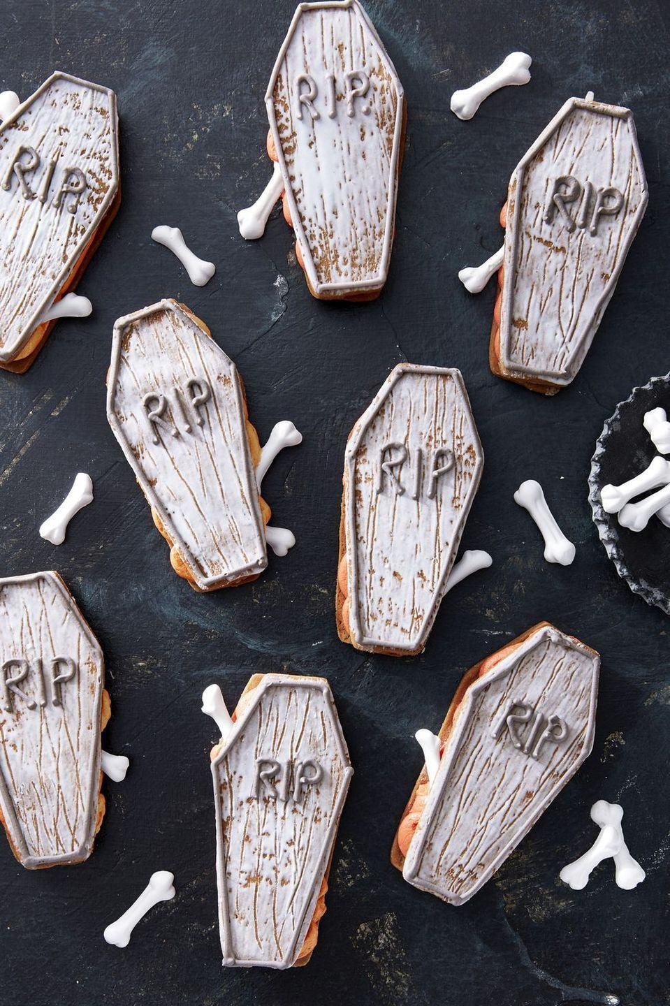 """<p>These chocolate molasses cookies sandwiched with buttercream frosting look freakishly real. Better eat 'em all before they come back to life.</p><p><em><a href=""""https://www.countryliving.com/food-drinks/a28943552/coffin-sandwich-cookies/"""" rel=""""nofollow noopener"""" target=""""_blank"""" data-ylk=""""slk:Get the recipe from Country Living »"""" class=""""link rapid-noclick-resp"""">Get the recipe from Country Living »</a></em></p>"""