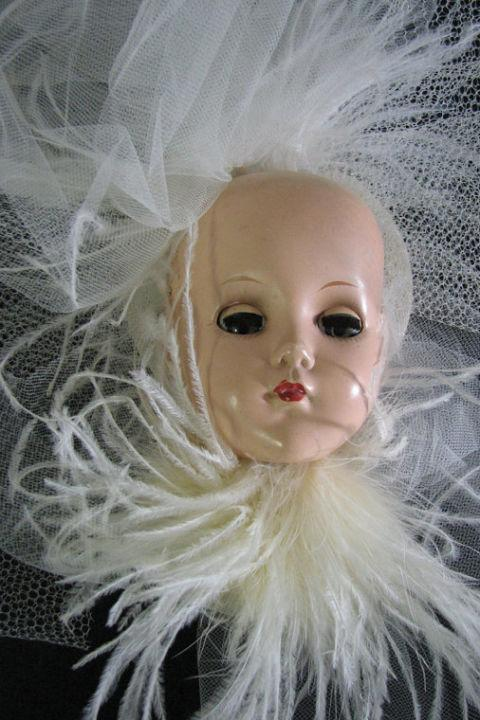 """<p>This is marketed as a """"creepy and wonderful Baby Doll 'Doll Hat.'"""" And, yes, if you're wondering, the eyes <em>do</em>still open and close when you move it.</p><p><em><a rel=""""nofollow"""" href=""""https://www.etsy.com/listing/86932870/hat-fascinator-hair-piece-baby-dearest?ga_order=most_relevant&ga_search_type=all&ga_view_type=gallery&ga_search_query=unusual%20wedding&ref=sr_gallery_27"""">Hat Fascinator Hair Piece Baby Dearest</a></em><span><em>, BORINGSIDNEY (Available on Etsy), $95</em></span><br></p>"""