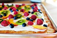 """<p>Does fruit belong on a pizza? Well, when the """"pizza"""" is a cookie cake covered in marshmallow cream cheese frosting, absolutely!</p><p><strong><a href=""""https://thepioneerwoman.com/cooking/fruit-pizza/"""" rel=""""nofollow noopener"""" target=""""_blank"""" data-ylk=""""slk:Get the recipe."""" class=""""link rapid-noclick-resp"""">Get the recipe.</a></strong></p><p><strong><a class=""""link rapid-noclick-resp"""" href=""""https://go.redirectingat.com?id=74968X1596630&url=https%3A%2F%2Fwww.walmart.com%2Fip%2FWilton-Bake-It-Better-Non-Stick-Baking-Pan-Set-3-Piece%2F44432741&sref=https%3A%2F%2Fwww.thepioneerwoman.com%2Ffood-cooking%2Fmeals-menus%2Fg32109085%2Ffourth-of-july-desserts%2F"""" rel=""""nofollow noopener"""" target=""""_blank"""" data-ylk=""""slk:SHOP BAKING SHEETS"""">SHOP BAKING SHEETS</a><br></strong></p>"""