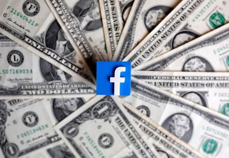 FILE PHOTO: A 3-D printed Facebook logo is seen on U.S. dollar banknotes in this illustration picture