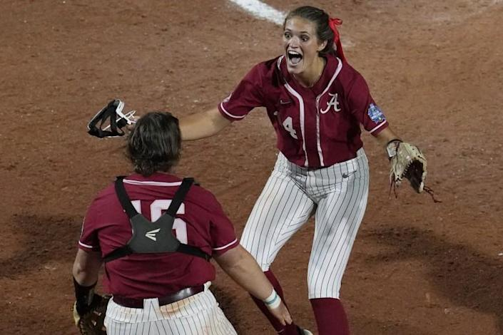 Alabama pitcher Montana Fouts, right, celebrates her perfect game with Bailey Hemphill.