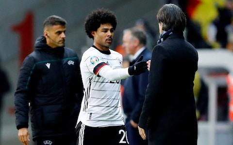 <span>Serge Gnabry shakes hands with Joachim Loew; the latter is rebuilding his Germany side</span> <span>Credit: REUTERS </span>