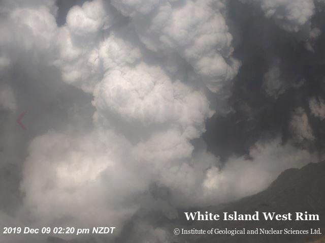 An aerial view shows smoke bellowing above the crater of Whakaari, also known as White Island, volcano as it erupts in New Zealand