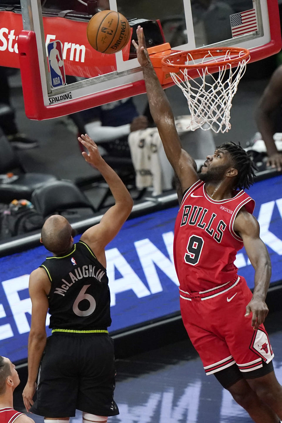 Chicago Bulls forward Patrick Williams, right, blocks a shot by Minnesota Timberwolves guard Jordan McLaughlin during the first half of an NBA basketball game in Chicago, Wednesday, Feb. 24, 2021. (AP Photo/Nam Y. Huh)