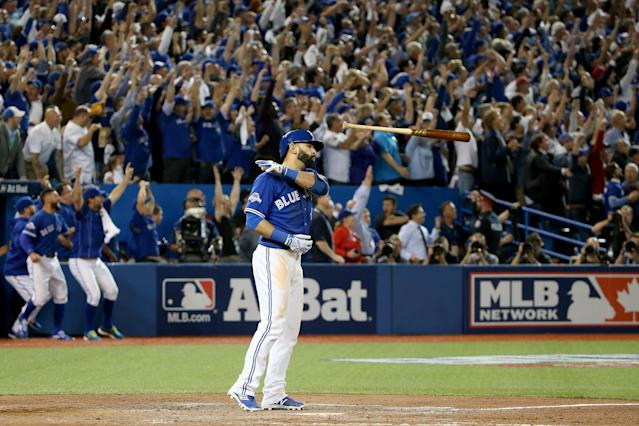 Jose Bautista is working his way back as a two-way player. (Photo by Tom Szczerbowski/Getty Images)
