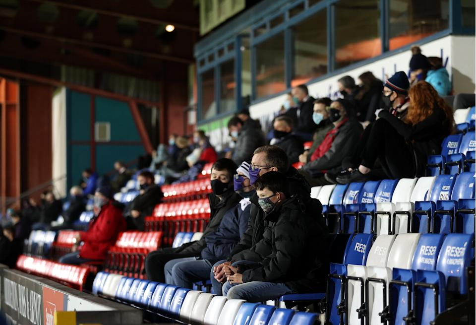 Fans in PPE in the stands before the Scottish Premiership match at the Global Energy Stadium, Dingwall.