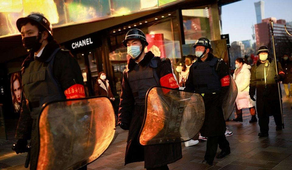 Security guards patrol in a shopping district during the Lunar New Year holiday in Beijing, China on Tuesday. Photo: Reuters