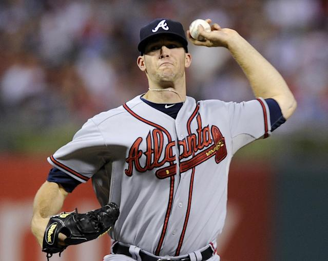 Atlanta Braves' Alex Wood throws a pitch in the first inning of a baseball game against the Philadelphia Phillies on Sunday, Aug. 4, 2013, in Philadelphia. (AP Photo/Michael Perez)