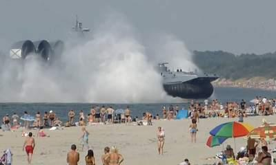 Russian Navy Hovercraft Lands On Busy Beach