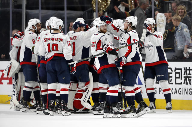 Members of the Washington Capitals celebrate after they defeated the Vegas Golden Knights 3-2 in Game 2 of the NHL hockey Stanley Cup Finals on Wednesday, May 30, 2018, in Las Vegas. (AP Photo/John Locher)