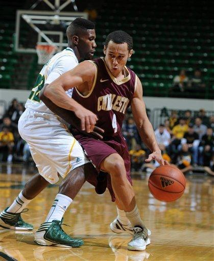 College of Charleston's Andrew Lawrence (4), right, is pressured by Baylor's A.J. Walton (22), left, in the first half of an NCAA college basketball game on Saturday Nov. 24, 2012, in Waco, Texas. (AP Photo/Waco Tribune Herald, Rod Aydelotte)