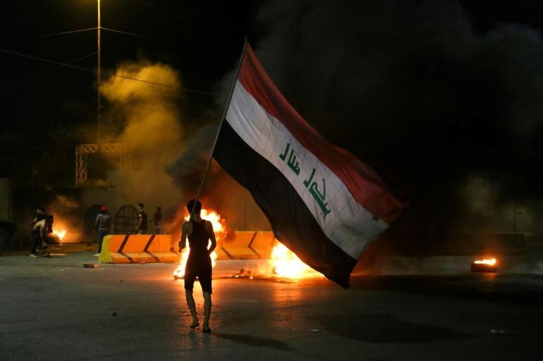 Iraqi protesters burned tyres in front of the Karbala governorate headquarters following Wazni's killing