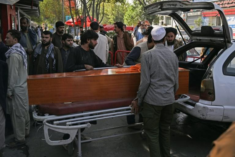 The airport attack lays bare a years-long fight between the Taliban and IS-K (AFP/Aamir QURESHI)
