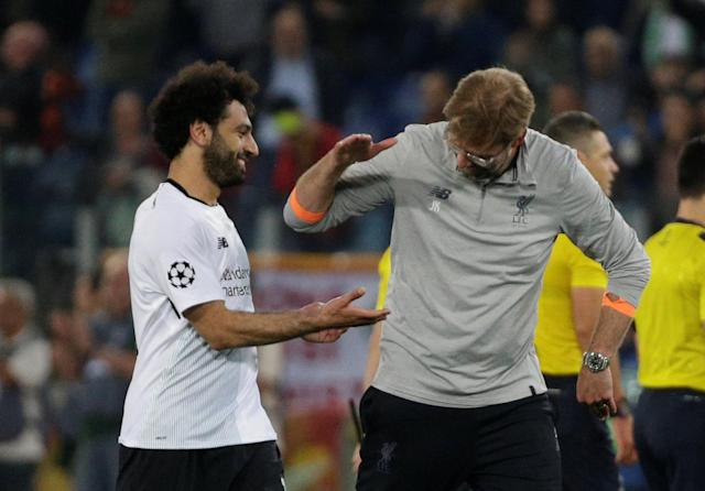 Soccer Football - Champions League Semi Final Second Leg - AS Roma v Liverpool - Stadio Olimpico, Rome, Italy - May 2, 2018 Liverpool manager Juergen Klopp and Mohamed Salah celebrate after the match REUTERS/Max Rossi