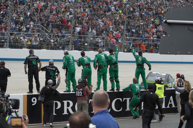 Kyle Larson's team celebrates on pit road after his win in the NASCAR Cup Series playoff auto race Sunday, Oct. 6, 2019, at Dover International Speedway in Dover, Del. (AP Photo/Jason Minto)