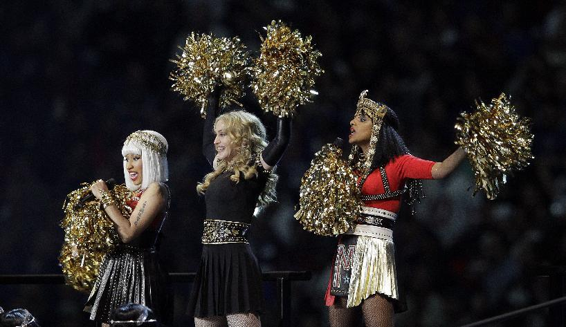 Madonna, center, performs with Nicki Minaj, left, and M.I.A. during halftime of the NFL Super Bowl XLVI football game between the New England Patriots and the New York Giants, Sunday, Feb. 5, 2012, in Indianapolis. (AP Photo/Michael Conroy)
