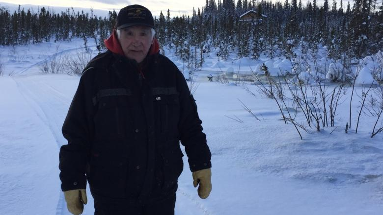 Tsiigehtchic, N.W.T., elder wants government to solve drainage problem near cabin