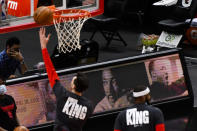 Houston Rockets players warm-up wearing shirts that honors Dr. Martin Luther King Jr., before an NBA basketball game against the Chicago Bulls, Monday, Jan. 18, 2021, in Chicago. (AP Photo/Matt Marton)