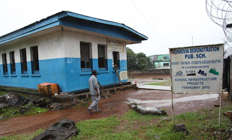 A man walks on July 31, 2014 past a school in Monrovia closed down by the Liberian government to protect students from contracting Ebola (AFP Photo/)