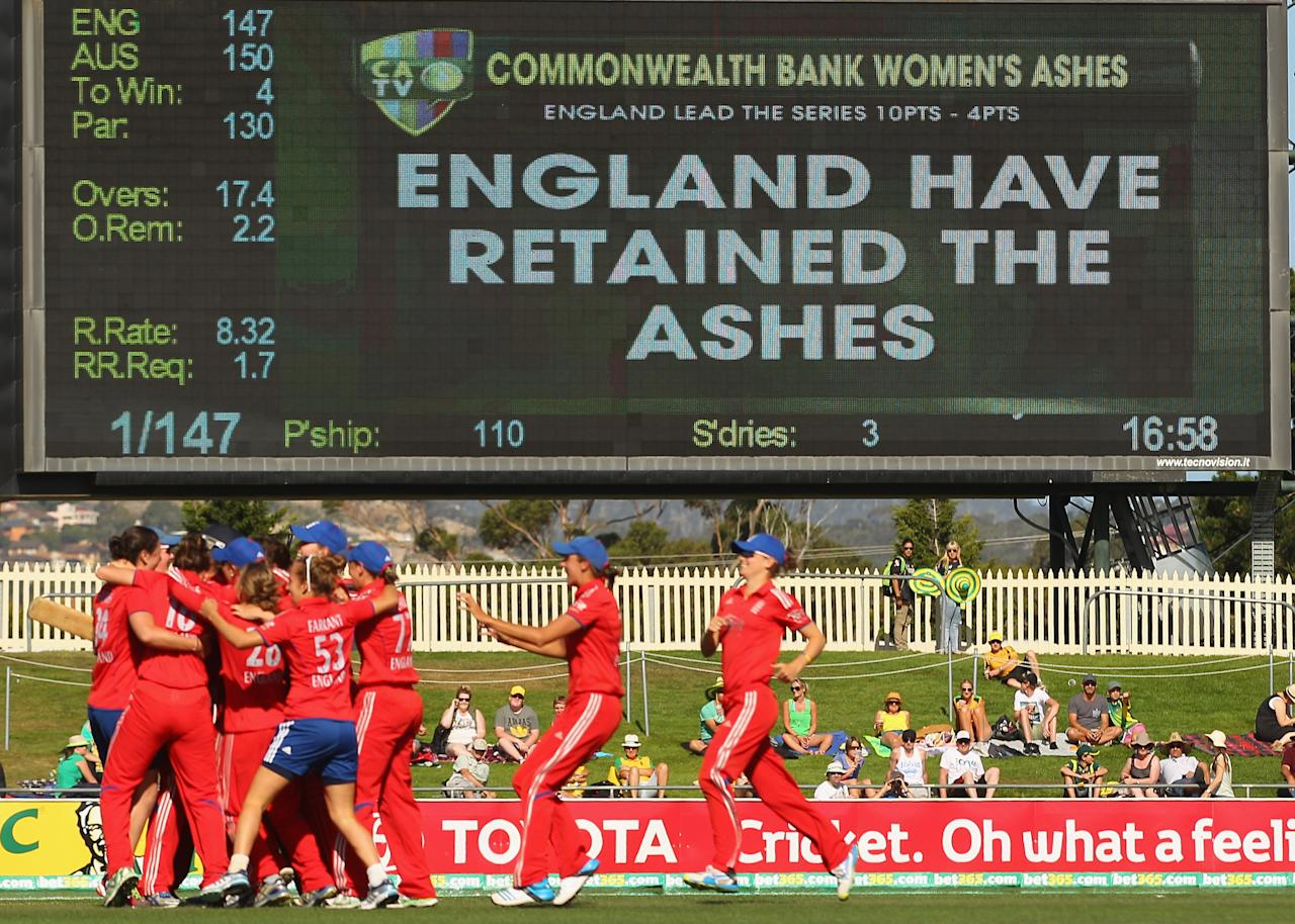 HOBART, AUSTRALIA - JANUARY 29:  England celebrate after winning the match and retaining the Ashes during game one of the International Twenty20 series between Australia and England at Blundstone Arena on January 29, 2014 in Hobart, Australia.  (Photo by Scott Barbour/Getty Images)
