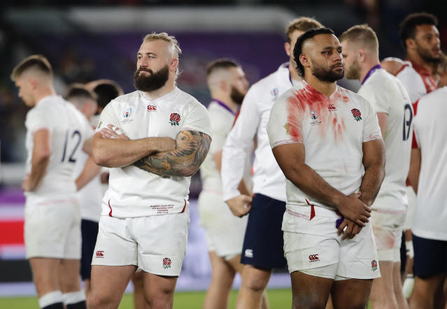 England's Billy Vunipola, right, and Joe Marler react at the end of the match after South Africa defeated England to win the Rugby World Cup final at International Yokohama Stadium in Yokohama, Japan, Saturday, Nov. 2, 2019. (AP Photo/Christophe Ena)