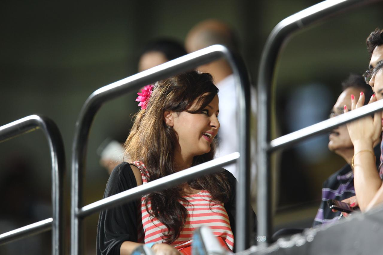 Sakshi Singh Rawat (L), wife of Chennai Super Kings Captain Mahendra Singh Dhoni, looks on in the grandstand during the IPL Twenty20 cricket match between Chennai Super Kings and Kolkatta Knight Riders.