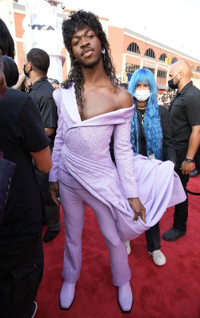 <p>The rapper wore a lilac two-piece by Atelier Versace.</p>