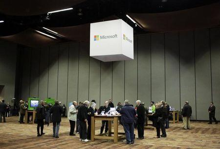 Microsoft Corp shareholders look at Microsoft products before the start of the annual shareholders' meeting in Bellevue, Washington December 3, 2014. REUTERS/Jason Redmond