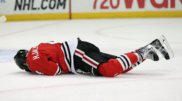 CHICAGO, IL - MAY 04: Niklas Hjalmarsson #4 of the Chicago Blackhawks lays on the ice after being hit by the puck against the Minnesota Wild in Game Two of the Second Round of the 2014 NHL Stanley Cup Playoffs at the United Center on May 4, 2014 in Chicago, Illinois. (Photo by Jonathan Daniel/Getty Images)