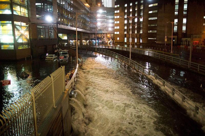 Seawater floods the entrance to the Brooklyn Battery Tunnel during Superstorm Sandy in New York on Oct. 29, 2012. (Photo: John Minchillo/AP)