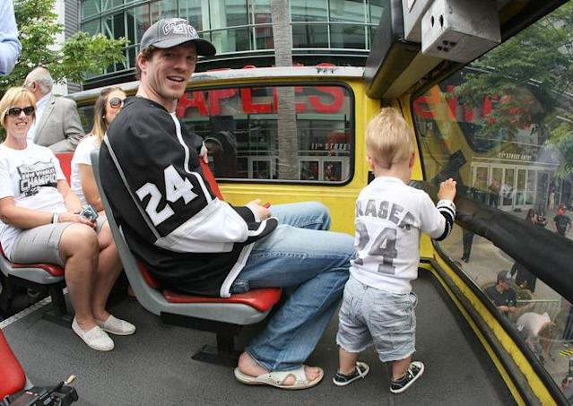 LOS ANGELES, CA - JUNE 14: Colin Fraser #24 of the Los Angeles Kings waits on the bus with his family prior to the Los Angeles Kings Stanley Cup Victory Parade on June 14, 2012 in Los Angeles, California. (Photo by Victor Decolongon/Getty Images)