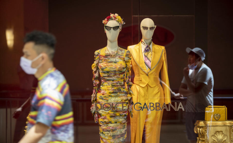 Due to social distancing, shoppers wait in line outside Dolce & Gabbana as South Coast Plaza reopens, requiring customers maintain a social distance and wear face masks at South Coast Plaza Monday.(Allen J. Schaben / Los Angeles Times via Getty Images)