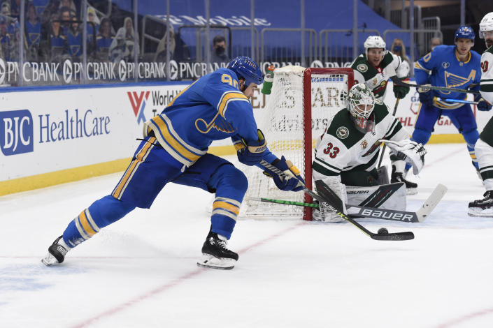 St. Louis Blues' Ryan O'Reilly (90) scores the winning goal past Minnesota Wild's Cam Talbot (33) during overtime of an NHL hockey game on Saturday, April 10, 2021, in St. Louis. (AP Photo/Joe Puetz)