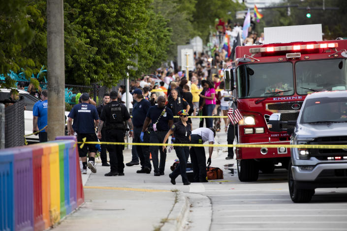 Police and firefighters respond after a truck drove into a crowd of people during The Stonewall Pride Parade and Street Festival in Wilton Manors, Fla., on Saturday, June 19, 2021. WPLG-TV reports that the driver of the truck was taken into custody. (Chris Day/South Florida Sun-Sentinel via AP)